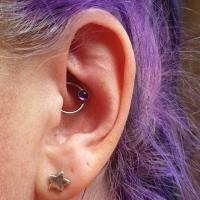 anatometal amethyst cabochon ring in daith piercing